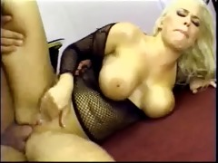 chesty blond wench in fishnet furiously sucks