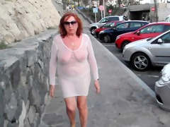 glamorous older bitch walks around the town with
