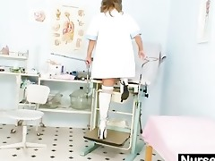 slender milf senior nurse toys her cunt on