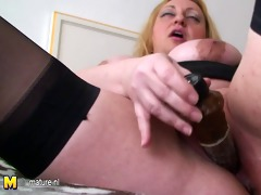 bulky large breasted mommy playing with a toy