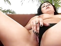 mature grace uses a sex toy on herself