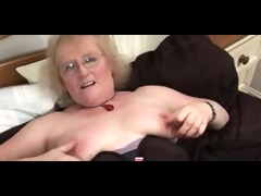 glorious granny in glasses and nylons teases and