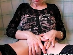 lustful grandma in nylons fists her unshaved muff