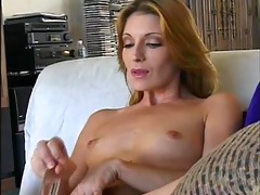 glamorous older cougar masturbates with sex tool