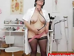 brunette hair practical nurse examining her vagina