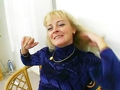 mature golden-haired is having enjoyment in the