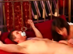 clothed milfs tie a chap to the ottoman