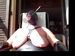 tied in public with hood and cigarette holder