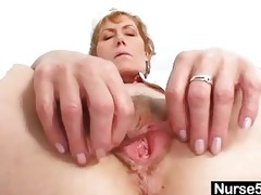 old mamma self exam on gynochair with speculum