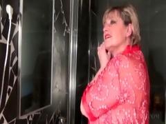golden-haired older dildoing her pussy