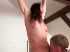 older babe hanging by a pole receives cookie