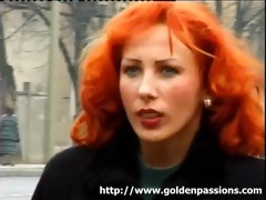 aged redhead taking a piddle in a public park