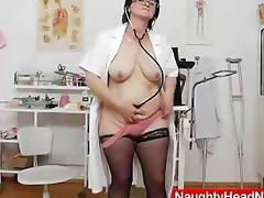 dark brown practical nurse examining her cum-hole