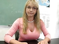 blonde older teacher shows off her gracious