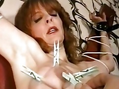 mature villein punished with clothespins