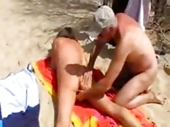 wife has pleasure with strangers at the beach.