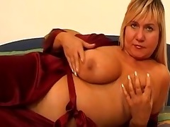 large titted older copulates herself