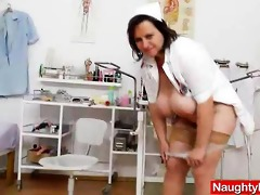 brunette hair lady practical nurse teases in