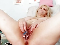 excited golden-haired older lady at gyno exam