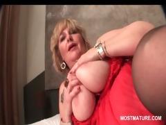 sex toy junkie older blond masturbating in sofa