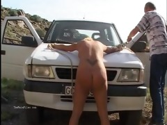 outdoor whipping of golden-haired wife in