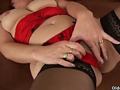 concupiscent granny in stockings is dildoing her