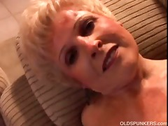 beautiful amateur grandma slides out of her pants